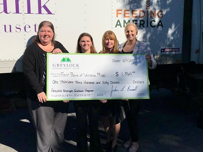 Greylock Employee Community Giveback Program (GECGP) raised $1,360 for the Food Bank of Western Massachusetts. (left to right) Greylock's Nikki Jannicelli, Marissa Kirchner, Jean Noel, and Heather Clark Corporate Relations Manager, Food Bank of Western Massachusetts.