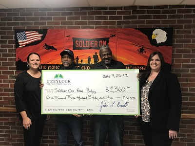 The Greylock Employee Community Giveback Program (GECGP) raised $1,360.00 for the Soldier on Food Pantry. (left to right) Greylock's Courtney DiCicco, Kenneth Sheldon, Melvin Collins, and Greylock's Becki Beron.